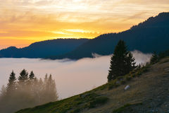 Mountain panorama high altitude, with hills and orange sky Royalty Free Stock Photography