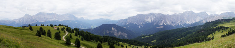 Mountain Panorama (Italy). Gigantic Panorama of the alpine Mountains in Italy. View from the top of a mountain at all summits of the mountains. Panoramic Royalty Free Stock Images