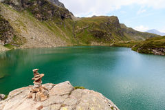 Mountain panorama and lake Lobbensee in Hohe Tauern Alps Royalty Free Stock Image