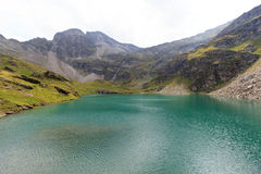 Mountain panorama and lake Lobbensee in Hohe Tauern Alps Royalty Free Stock Images