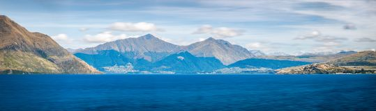Mountain Panorama of Lake Wakatipu, New Zealand. Mountain Panorama of Lake Wakatipu with the alpine town of Queenstown in the background in the Southern Island Royalty Free Stock Images