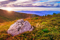 Mountain panorama with large rock on the hillside Stock Image