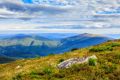 Mountain panorama with large rock on the hillside Royalty Free Stock Photo