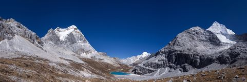 Mountain panorama at Milk Lake in Yading Nature Reserve in Sichuan, China stock photos
