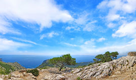 Mountain panorama with ocean view and blue sky Royalty Free Stock Image