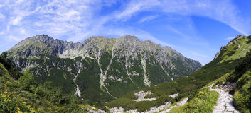 Mountain panorama with the path Royalty Free Stock Photo