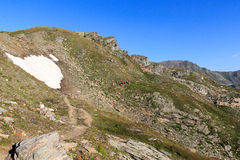 Mountain panorama and people hiking on footpath, Hohe Tauern Alps, Austria Royalty Free Stock Photography