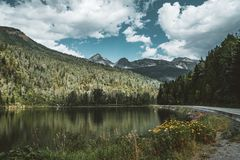 Mountain panorama with reflection flowers blue sky and clouds, British Columbia, Canada stock image