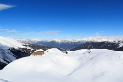 Mountain panorama with snow and blue sky in winter in Stubai Alps Stock Photos