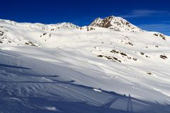 Mountain panorama with snow and blue sky in winter in Stubai Alps Royalty Free Stock Image