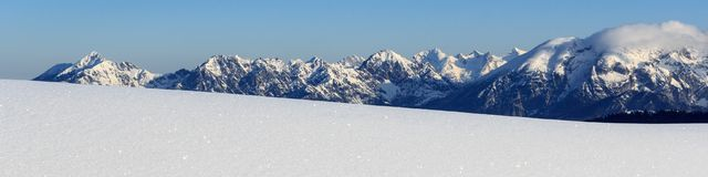 Mountain panorama with snow and blue sky in winter in Stubai Alps Stock Image