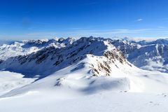 Mountain panorama with snow and blue sky in winter in Stubai Alps Stock Images