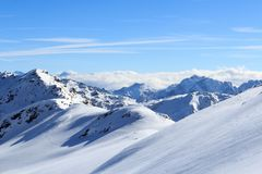 Mountain panorama with snow and blue sky in winter in Stubai Alps Royalty Free Stock Photo