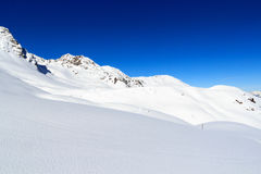 Mountain panorama with snow and blue sky in winter in Stubai Alps Royalty Free Stock Images