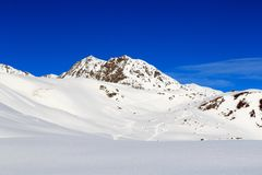 Mountain panorama with snow and ski tracks in winter in Stubai Alps Royalty Free Stock Photo
