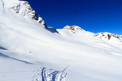 Mountain panorama with snow and snowshoe trail in winter in Stubai Alps Stock Photos
