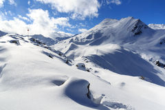Mountain panorama with snow and snowshoe trail in winter in Stubai Alps Stock Photo