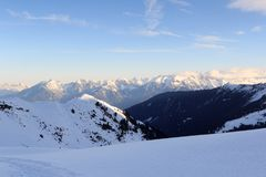 Mountain panorama with snow and snowshoe trail in winter in Stubai Alps Royalty Free Stock Photography