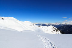 Mountain panorama with snow and snowshoe trail in winter in Stubai Alps Royalty Free Stock Photos