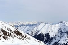 Mountain panorama with snow, trees and blue sky in winter in Stubai Alps. Austria Royalty Free Stock Photography