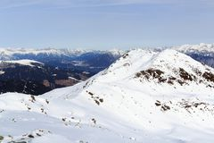 Mountain panorama with snow, trees and blue sky in winter in Stubai Alps. Austria Royalty Free Stock Photo