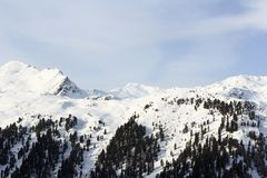 Mountain panorama with snow, trees and blue sky in winter in Stubai Alps. Austria Stock Photo