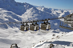 Mountain panorama with three gondolas. The gondolas move past always in pairs of three at the cable car in Val Thorens, France Stock Photo