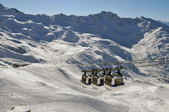 Mountain panorama with three gondolas. The gondolas move past always in pairs of three at the cable car in Val Thorens, France stock photography