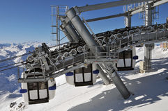 Mountain panorama with three gondolas. The gondolas move past always in pairs of three at the cable car in Val Thorens, France royalty free stock photos