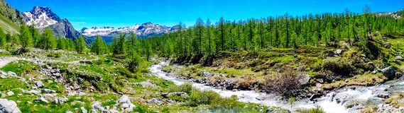 Mountain panorama with torrent full of water in summer Alpe Deve. Ro, Piedmont Italy Royalty Free Stock Photos