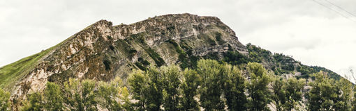 Mountain panorama. With trees and sky Royalty Free Stock Image