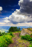 Mountain panorama with  white stone before the storm. Mountain panorama view from the cliff near the large white stone at the top before the storm Royalty Free Stock Image