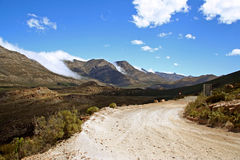 Mountain Pass. In South Africa with clouds pouring down the side of the mountain Royalty Free Stock Photo