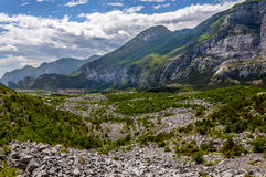 Mountain pass and city in Alps Royalty Free Stock Image