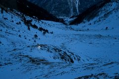 Mountain pass at night. Tourist with a flashlight looking for the trail in the mountains. Caucasian Mountains. Russia stock photos