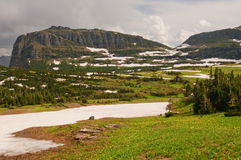 Mountain pass in summer snow Royalty Free Stock Photo