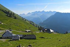 Mountain pasture dairy on the pass Col de Jaman. View towards Wildstrubel peak, Les Avants, Vaud, Switzerland Stock Images