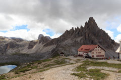 Mountain Paternkofel and alpine hut Dreizinnenhutte in Sexten Dolomites, South Tyrol Royalty Free Stock Images