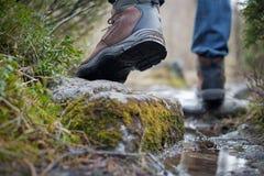 Mountain path. Close-up of man legs, walking on a mountain path Stock Photos