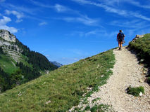 Mountain path. Hiker walking on mountain path stock photos