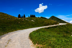 Mountain path. Empty mountain path winding in French Alps, Haute Savoie Stock Images