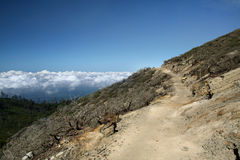Mountain path above clouds. Mountain path above the clouds, Ijehn volcano, Indonesia Royalty Free Stock Images