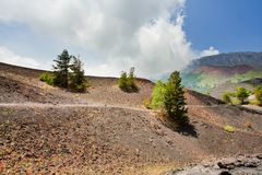 Mountain path in clinker ground on volcano Etna Royalty Free Stock Image