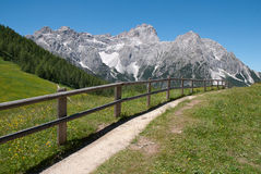 Mountain path and fence Stock Photo