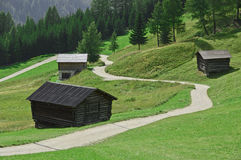 Mountain path between the huts. Part of the path towards Corvara from Mount Arlara Royalty Free Stock Photo