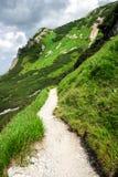 Mountain path. Path leading off to mountain peak Stock Photo