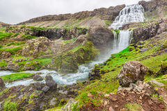 Mountain path leading to the waterfall in Iceland Stock Photo