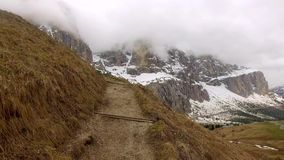 Mountain path in Passo Gardena in the Dolomites Mountains, South Tyrol, Italy stock video