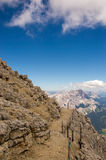 Mountain path. Protected path running alone the mountain slope, Tofane, Cortina d'Ampezzo Royalty Free Stock Photos