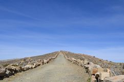Mountain path, trail at a sunny day with blue sky, Titicaca Lake, Bolivia. Mountain path, trail at a sunny day with blue sky, Titicaca Lake, Isla del Sol Royalty Free Stock Image